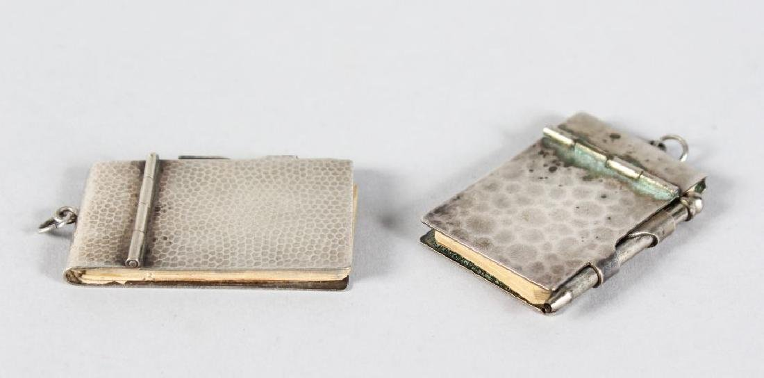 TWO SMALL SILVER MOUNTED NOTEBOOKS.