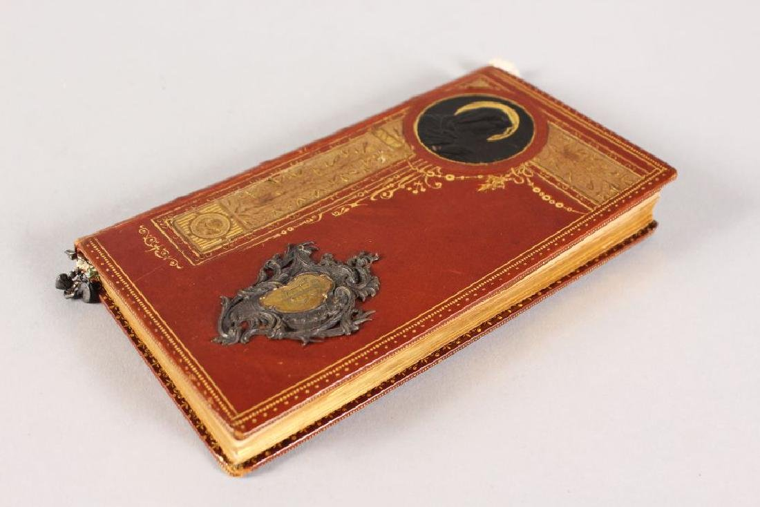 AN ITALIAN LEATHER BOUND PRAYER BOOK.