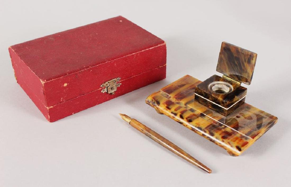 A TORTOISESHELL INKWELL and PEN, in original box.