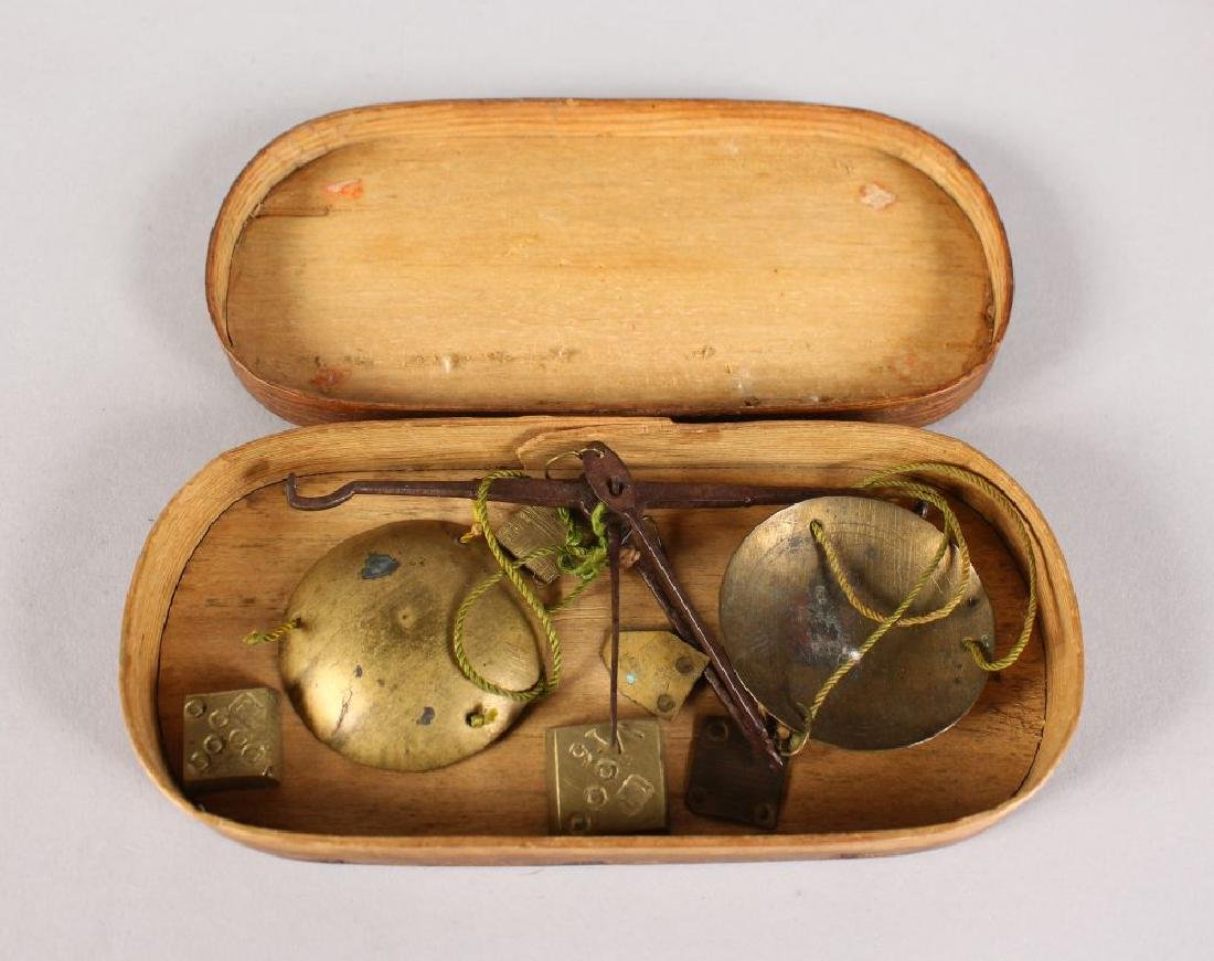 A BOXED SET OF SCALES AND WEIGHTS.