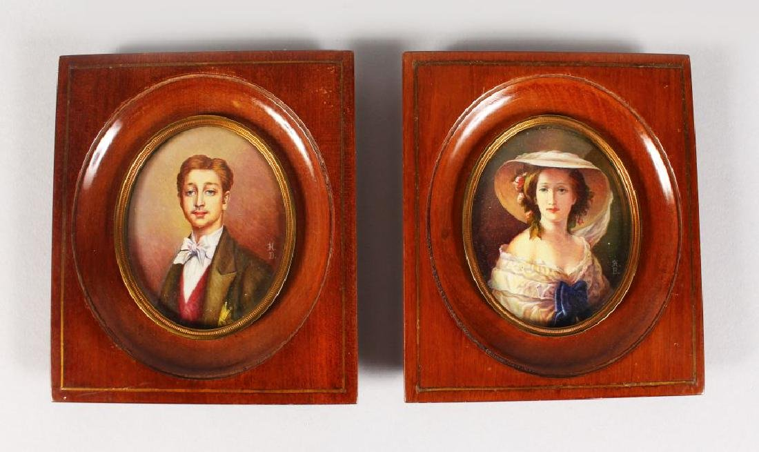A PAIR OF OVAL MINIATURES of A YOUNG LADY AND MAN.