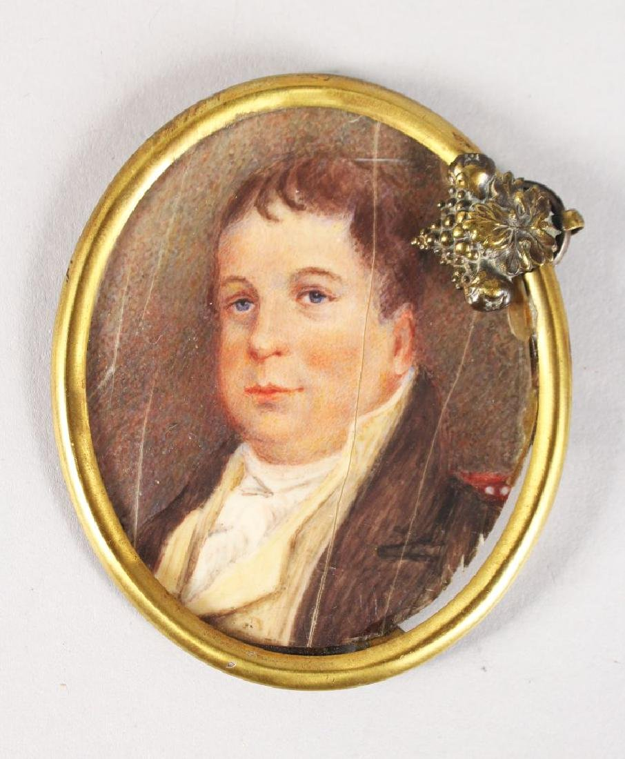 A GEORGIAN OVAL PORTRAIT, HEAD AND SHOULDERS OF A MAN.