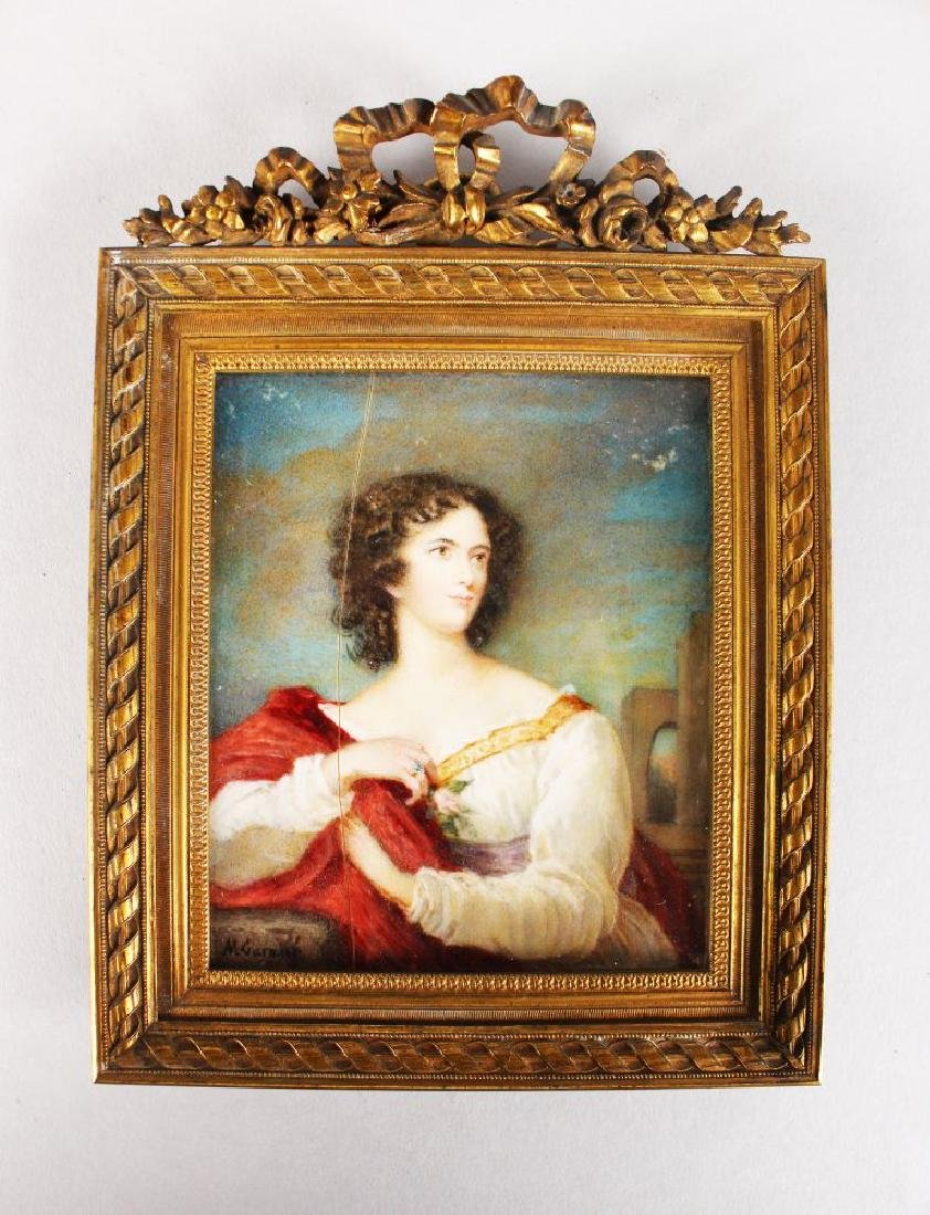 A GOOD MINIATURE OF A YOUNG LADY in an interior.