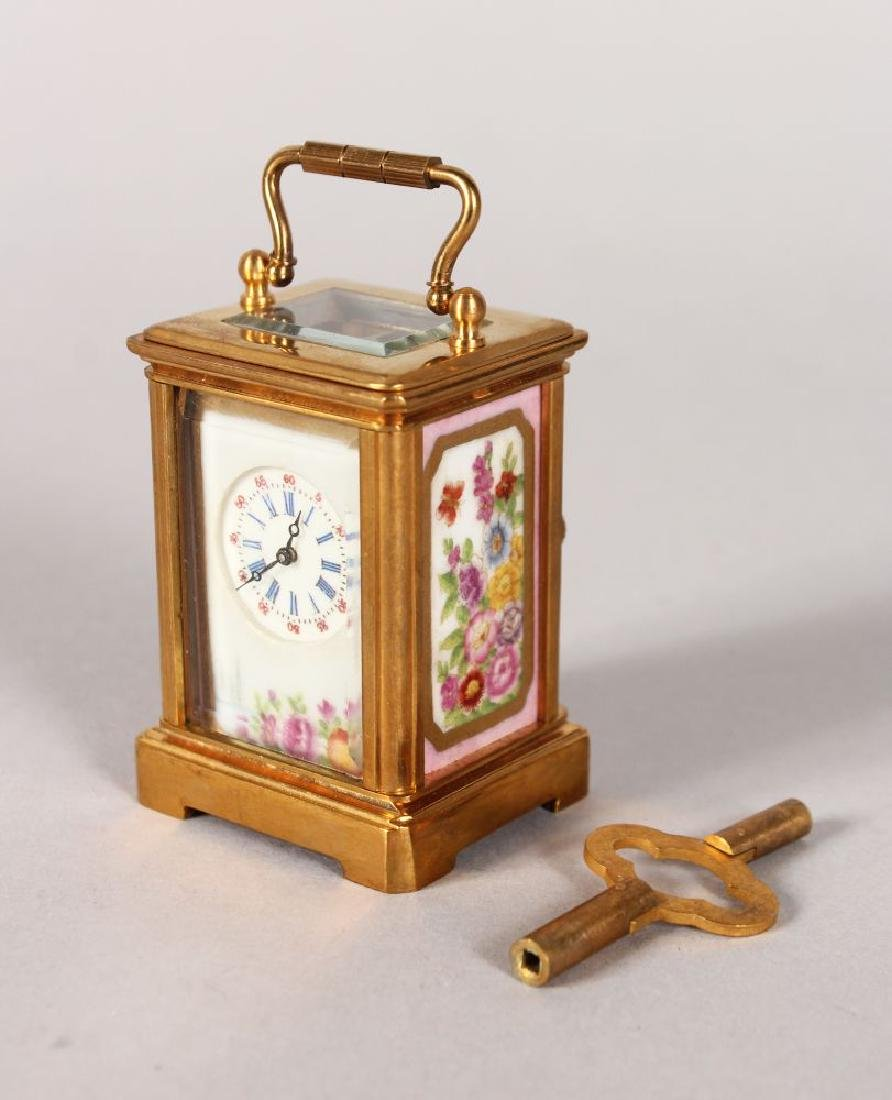 A MINIATURE PINK SEVRES PORCELAIN PANEL BRASS CARRIAGE