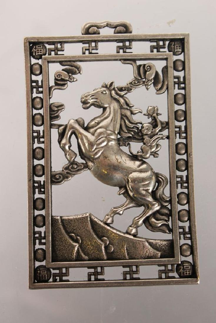 "A CHINESE SILVER PIERCED ""HORSE"" PENDANT."