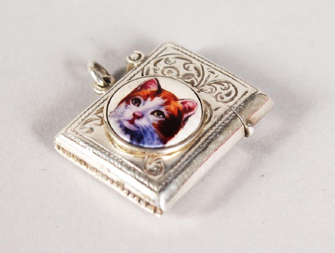 AN ENGRAVED SILVER VESTA with a circular enamel of a