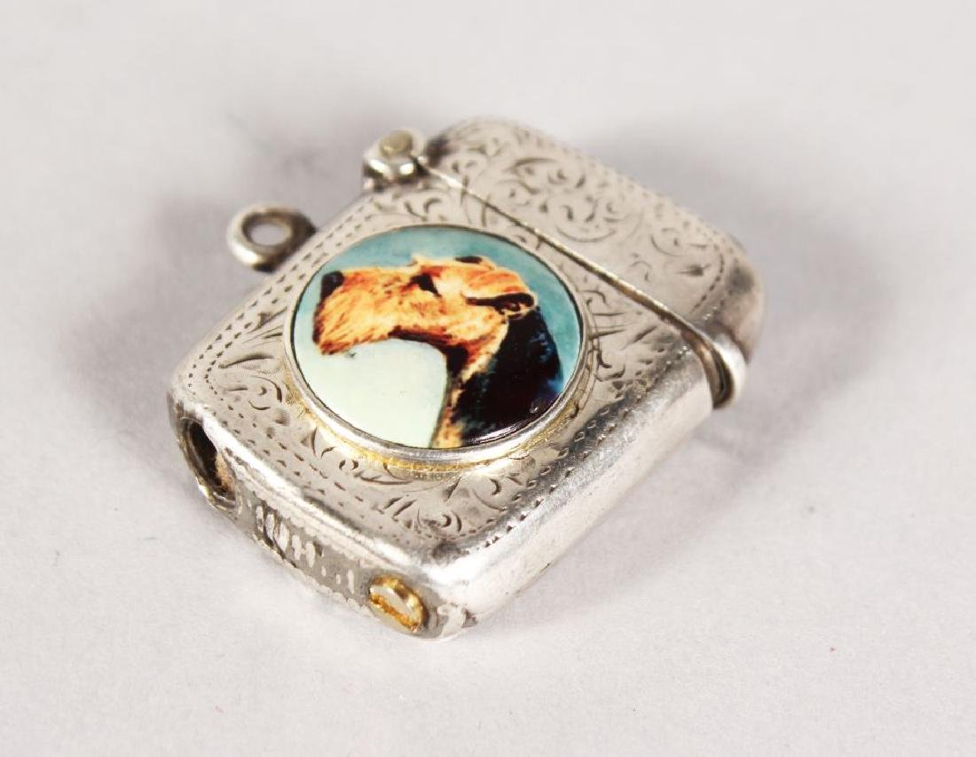 AN ENGRAVED SILVER LIGHTER with a circular enamel of a