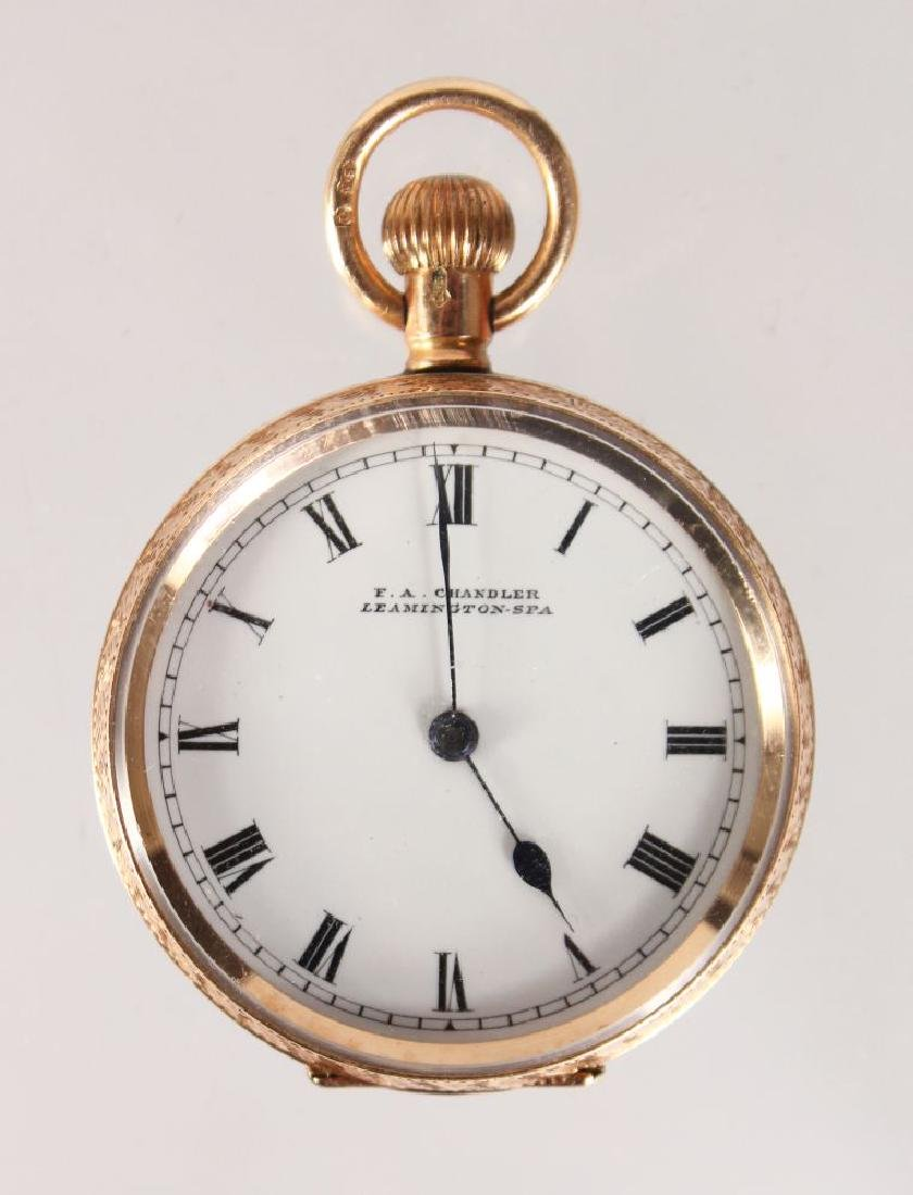 A LADIES ENGRAVED 9CT GOLD FOB WATCH.