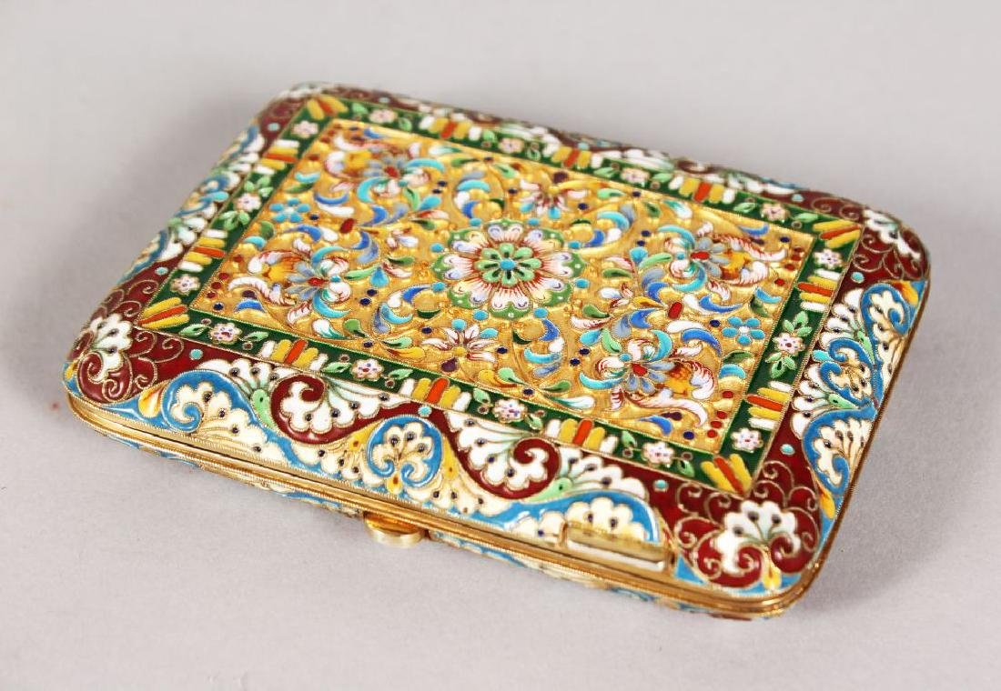 A SUPERG RUSSIAN SILVER GILT AND ENAMEL CIGARETTE CASE.