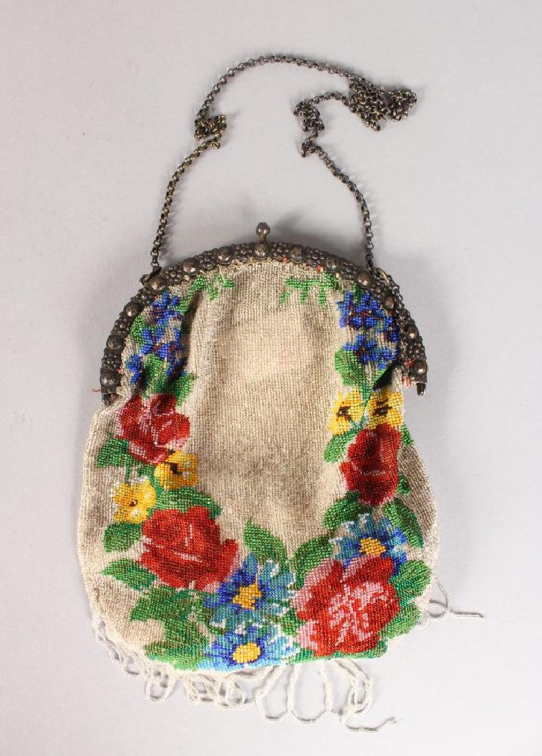 A SILVER MOUNTED BEAD WORK EVENING BAG.