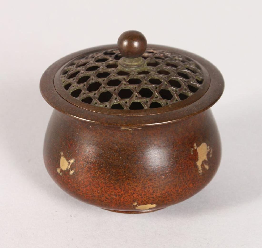 A SMALL CHINESE GOLD SPLASH CIRCULAR BRONZE CENSER AND