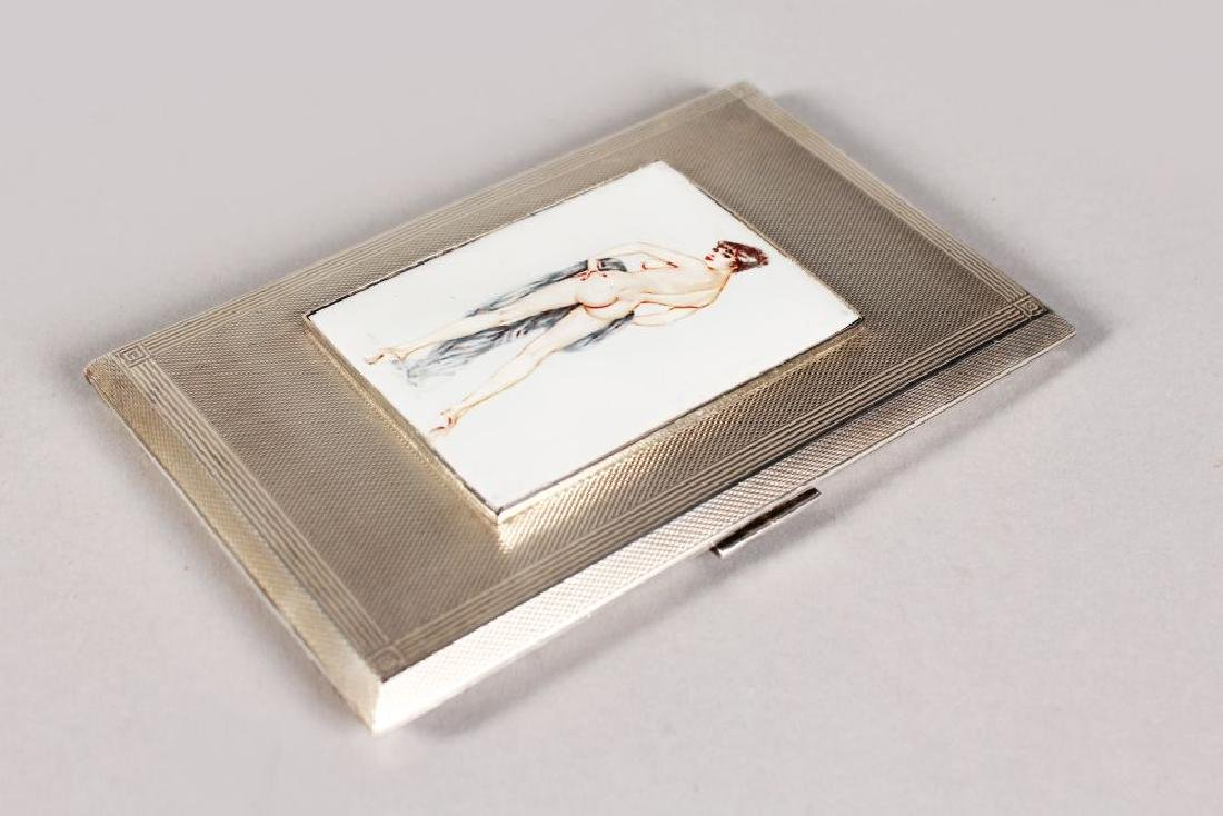 AN ENGINE TURNED CIGARETTE CASE, 5.25ins x 3ins, with