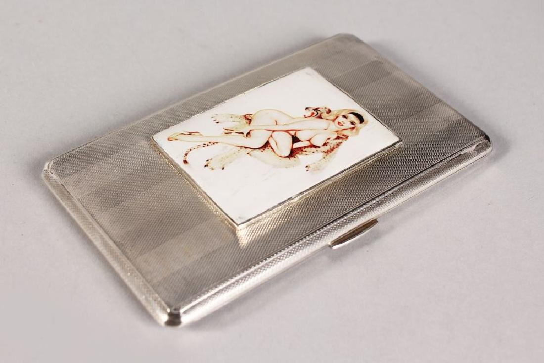 AN ENGINE TURNED CIGARETTE CASE, 5.5ins x 3.25ins,