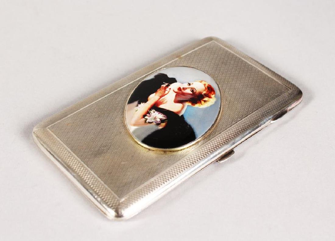 AN ENGINE TURNED CIGARETTE CASE, 5.5ins x 3.25ins, with
