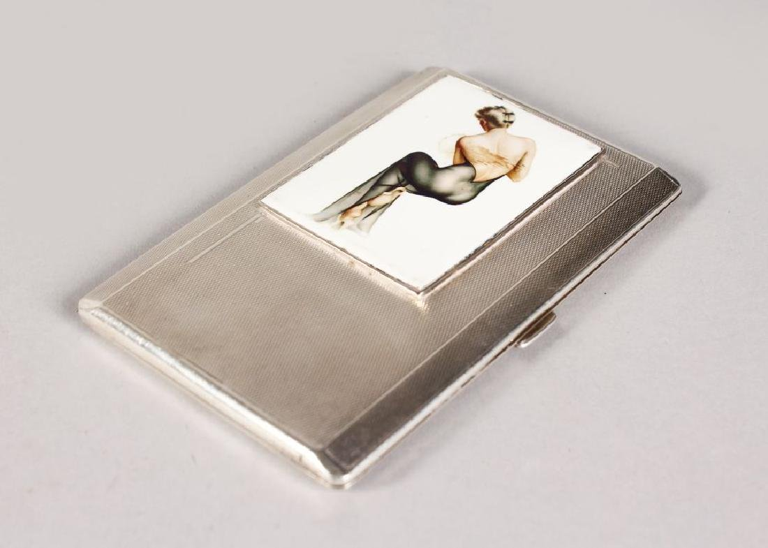 AN ENGINE TURNED CIGARETTE CASE, 5ins x 3.25ins, with