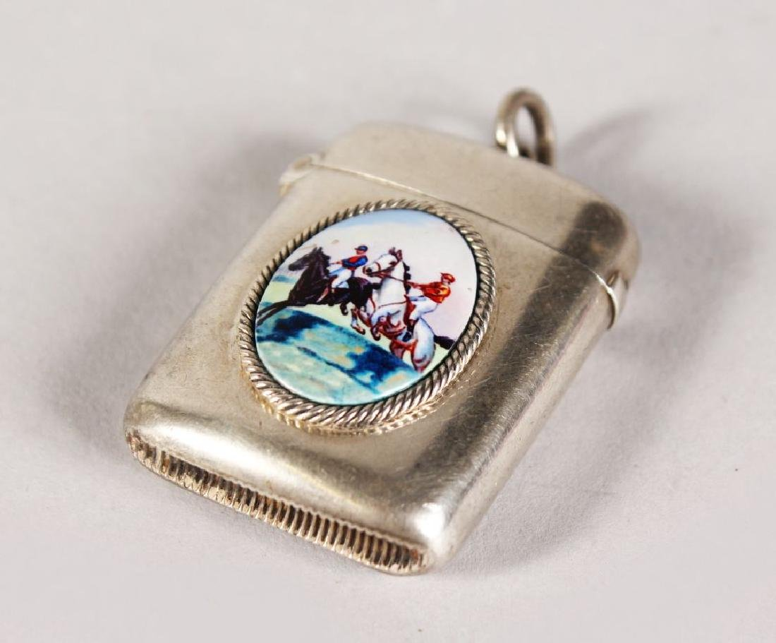 A VICTORIAN PLAIN SILVER VESTA with a steeplechase.