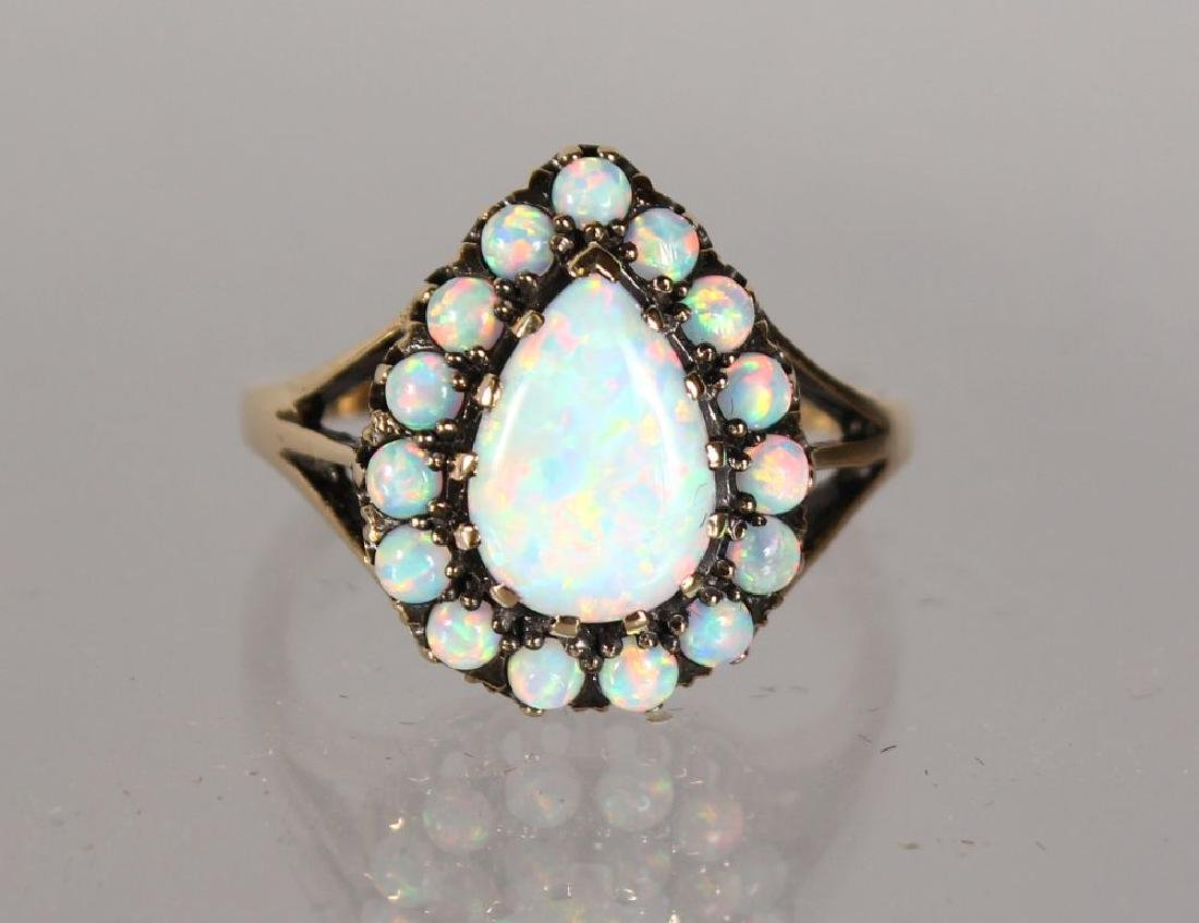 A GOOD 9CT GOLD PEAR SHAPE GILSON OPAL CLUSTER RING.