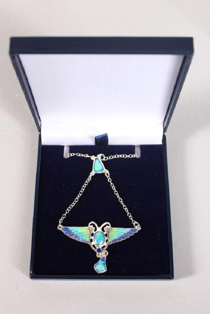 AN ART DECO SILVER AND ENAMEL SCARAB PENDANT AND CHAIN.