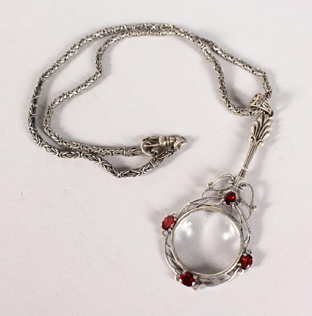 A SILVER SPY GLASS AND CHAIN.