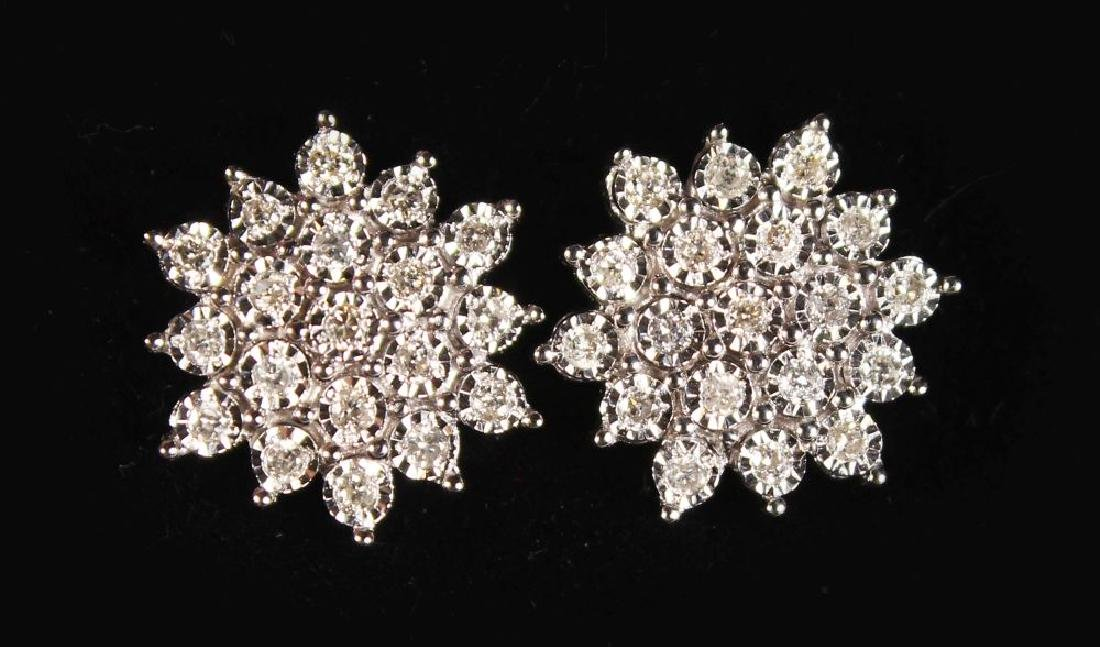 A PAIR OF 9CT GOLD DIAMOND CLUSTER EARRINGS.