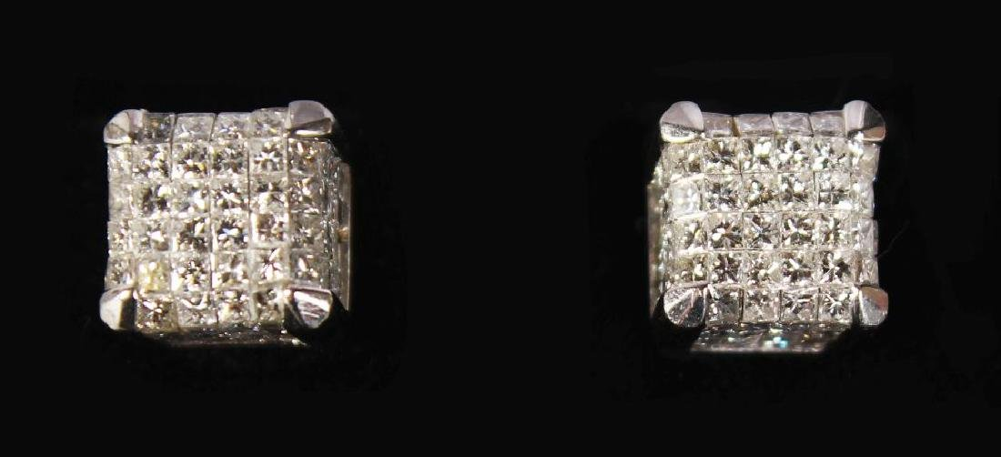 AN IMPRESSIVE PAIR OF WHITE GOLD AND DIAMOND EARRINGS