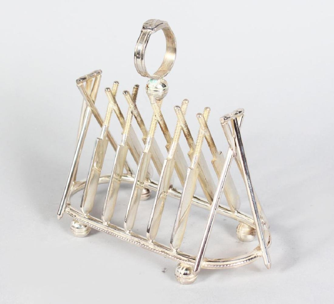 "A PLATED ""CRICKET"" TOAST RACK with six pairs of crossed"