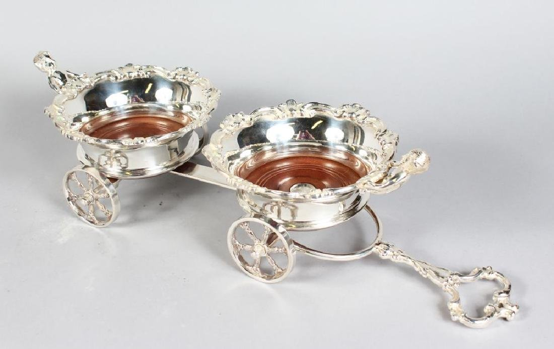 A GOOD SILVER PLATED DOUBLE COASTER CART with four