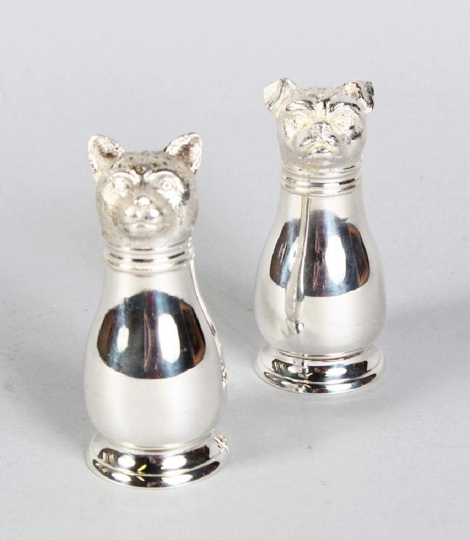 A PAIR OF DOG AND CAT SALT AND PEPPERS.
