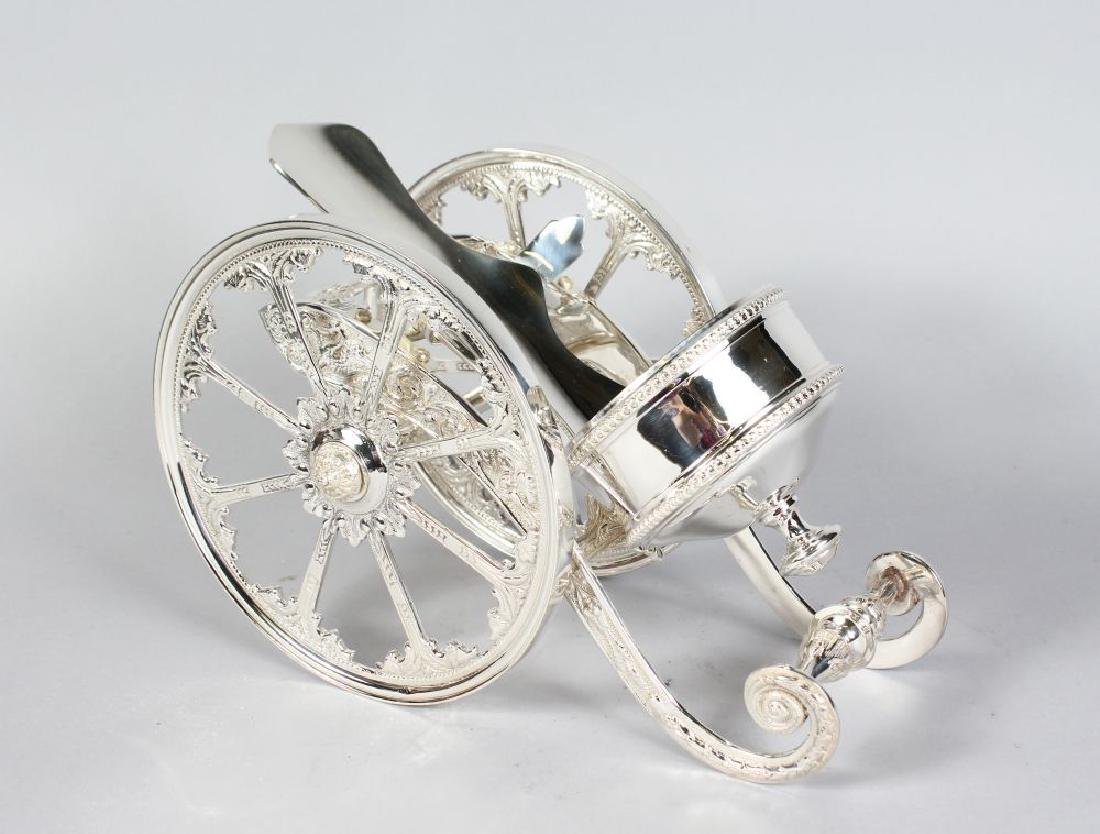 A LARGE PLATED CANNON BOTTLE HOLDER.