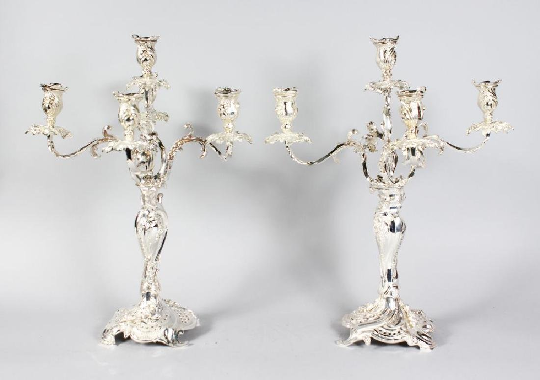 A GOOD PAIR OF PLATED FIVE LIGHT CANDELABRA with centre