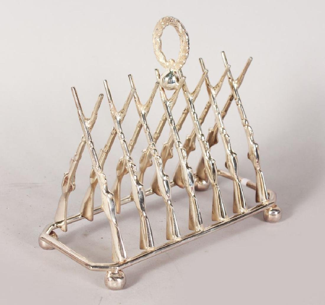 A PLATE TOAST RACK OF SEVEN PAIRS OF CROSSED RIFLES on