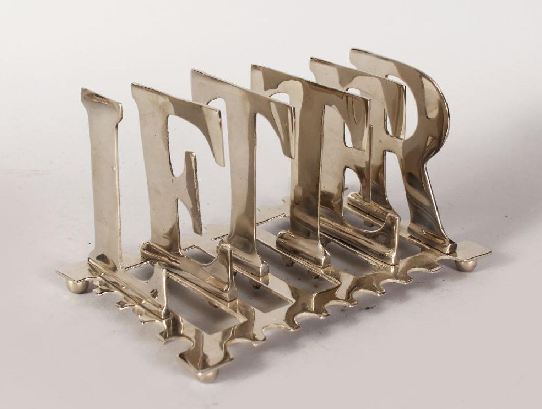 "A LARGE TOAST RACK formed with the ""LETTERS"".  8ins"