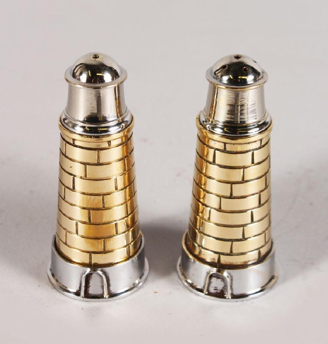 A PAIR OF PLATED LIGHTHOUSE SHAPE SALT AND PEPPER.