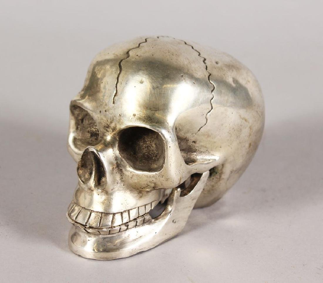 A PLATED MODEL OF A HUMAN SKULL, with articulated jaw.