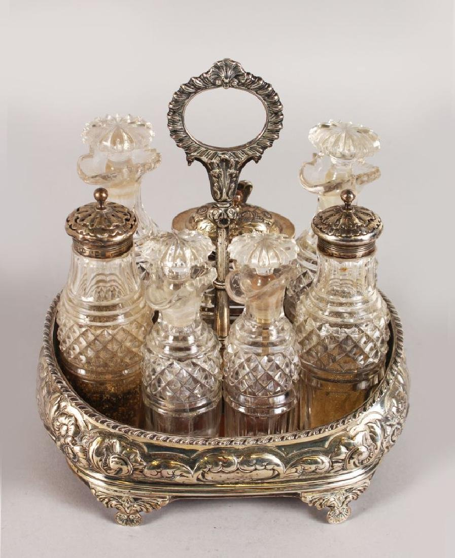 A GEORGE IV SEVEN BOTTLE CRUET with gadrooned handle