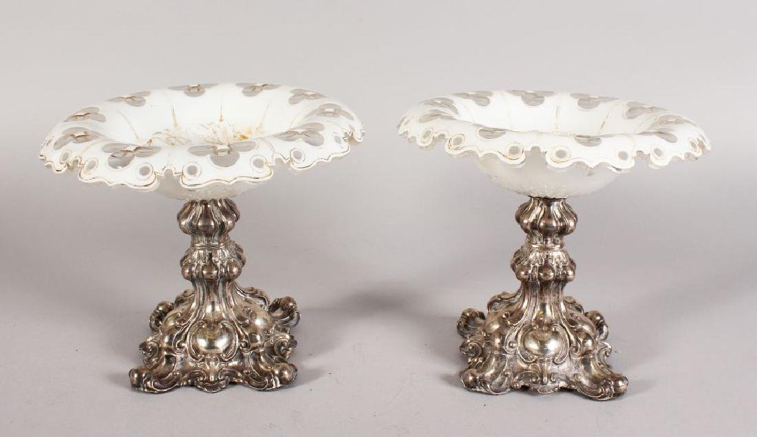 A PAIR OF SILVER AND OPAQUE GLASS COMPORTS, the shaped