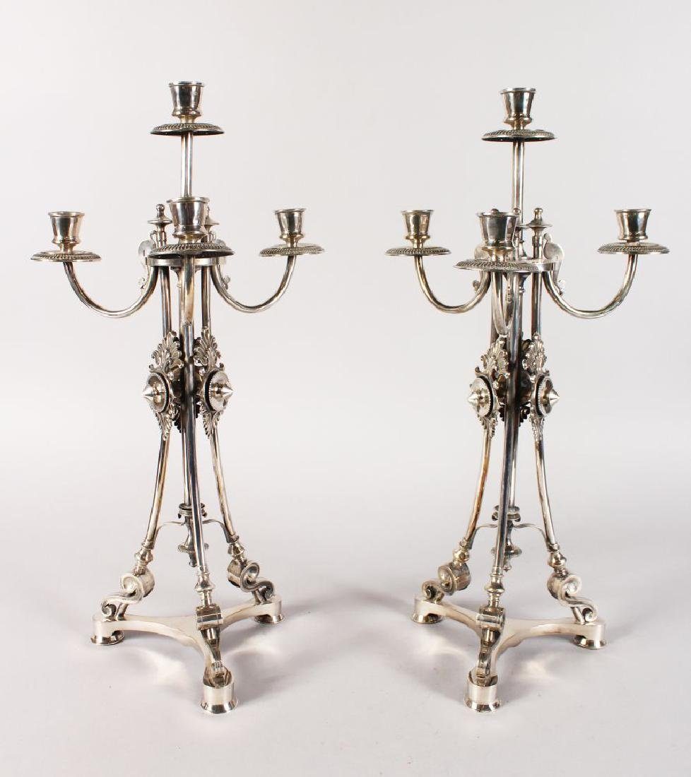 A GOOD PAIR OF CONTINENTAL SILVER FOUR LIGHT CANDELABRA