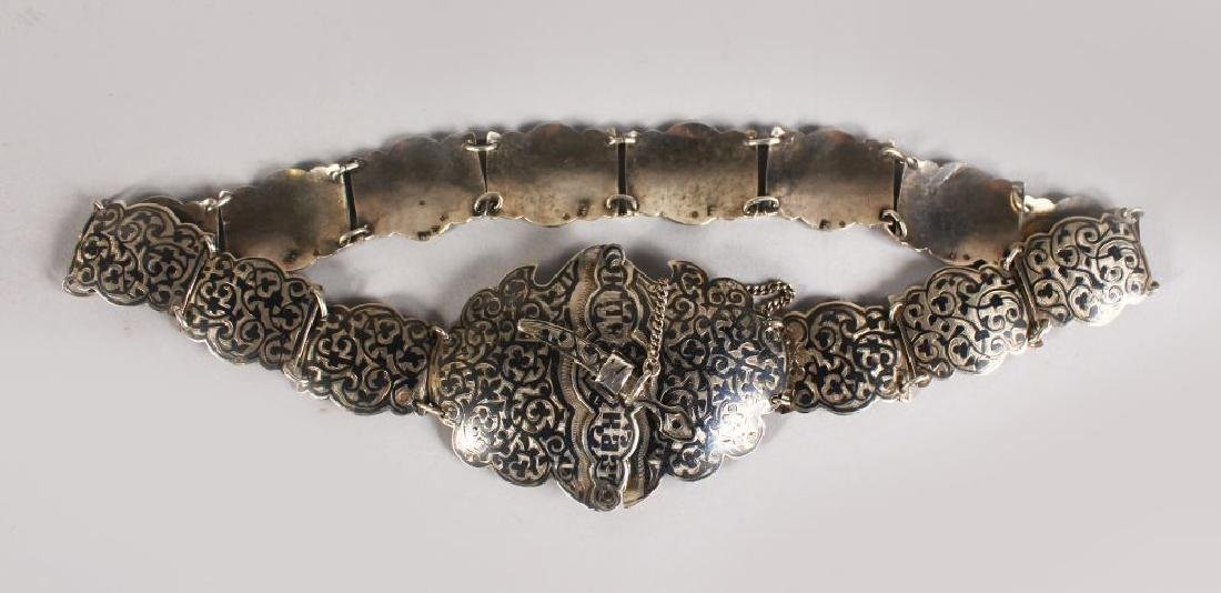 A CAUCASIAN SILVER AND NIELLO DECORATED BELT, with a
