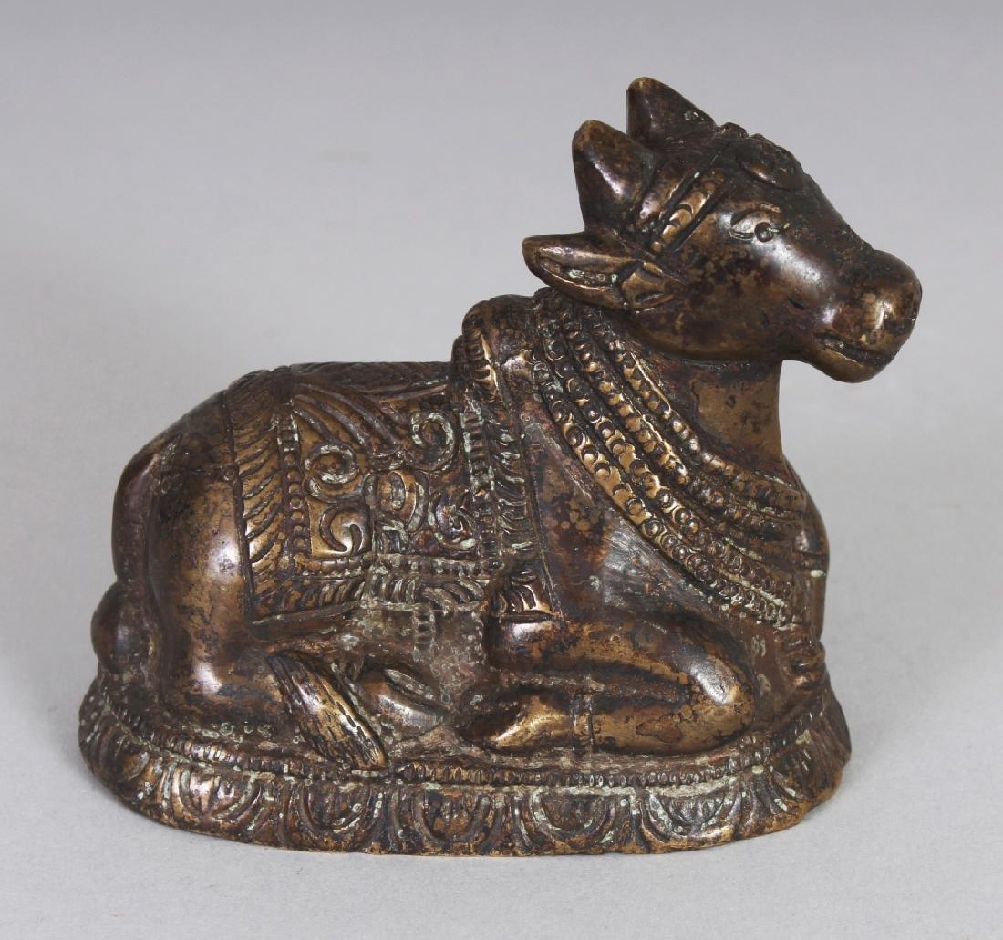 A SMALL 19TH CENTURY INDIAN BRONZE OF SHIVA'S NANDI
