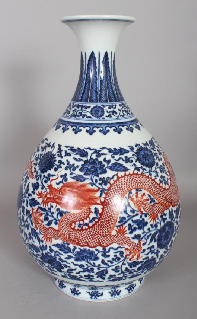 A CHINESE UNDERGLAZE-BLUE & IRON-RED PORCELAIN DRAGON
