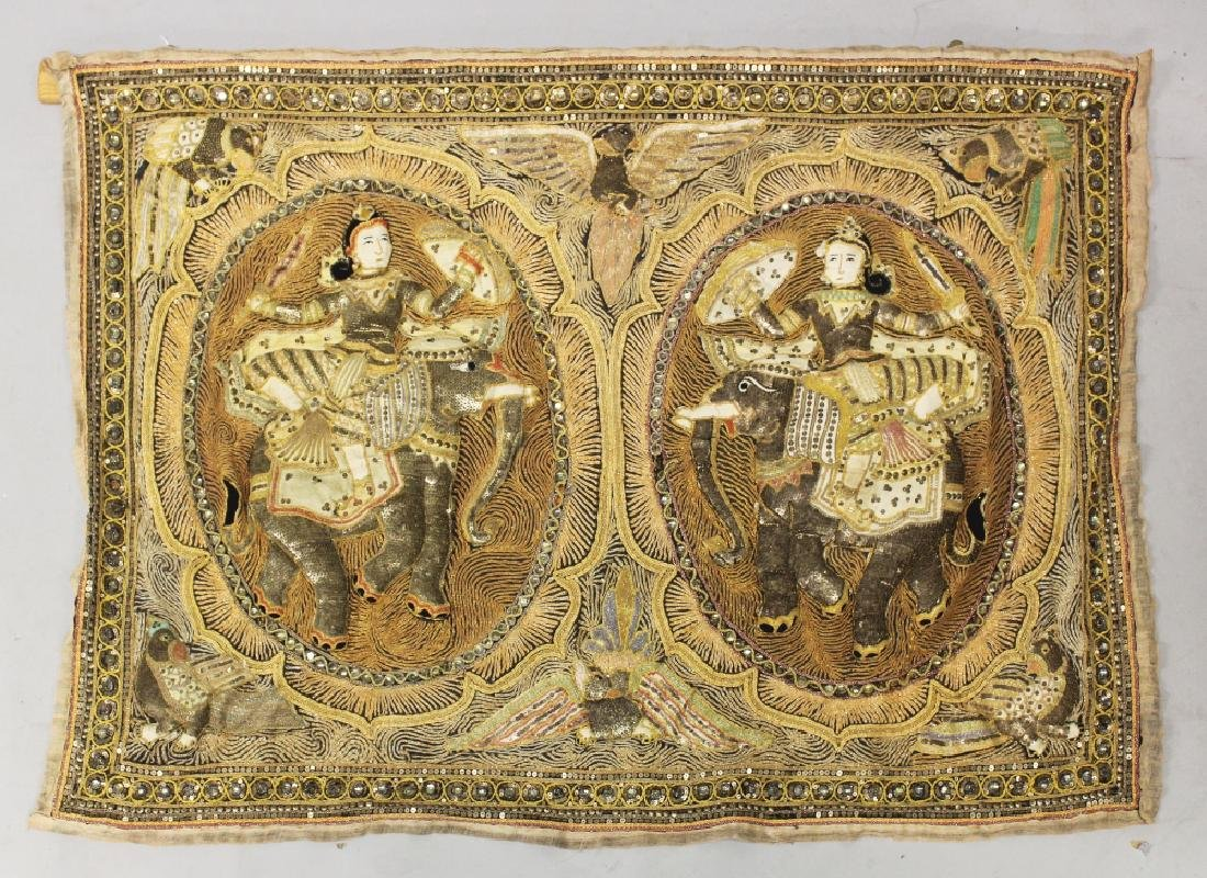 A 20TH CENTURY INDIAN FABRIC WALL HANGING, worked in