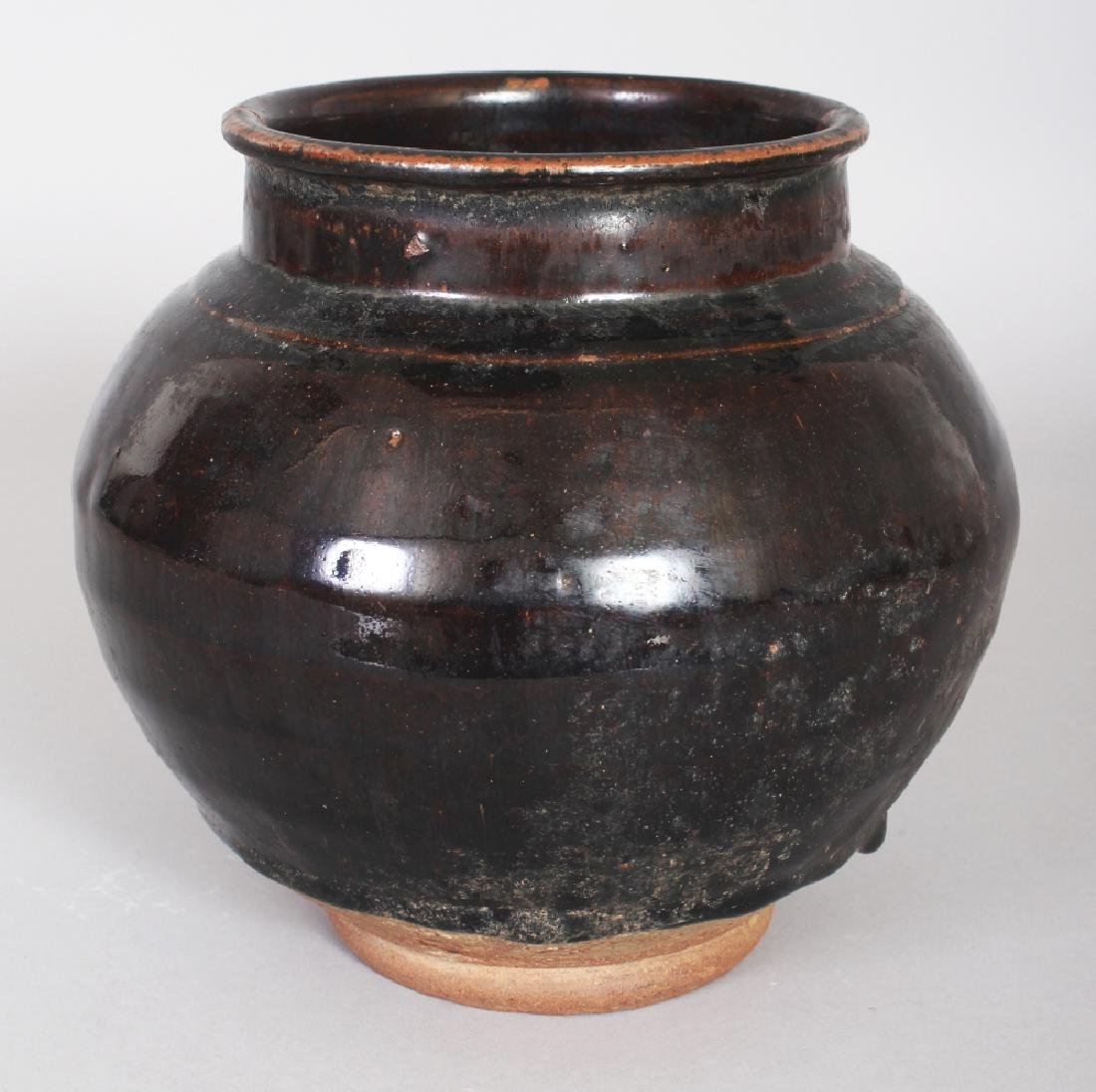 A CHINESE MING DYNASTY BROWN GLAZED STONEWARE STORAGE