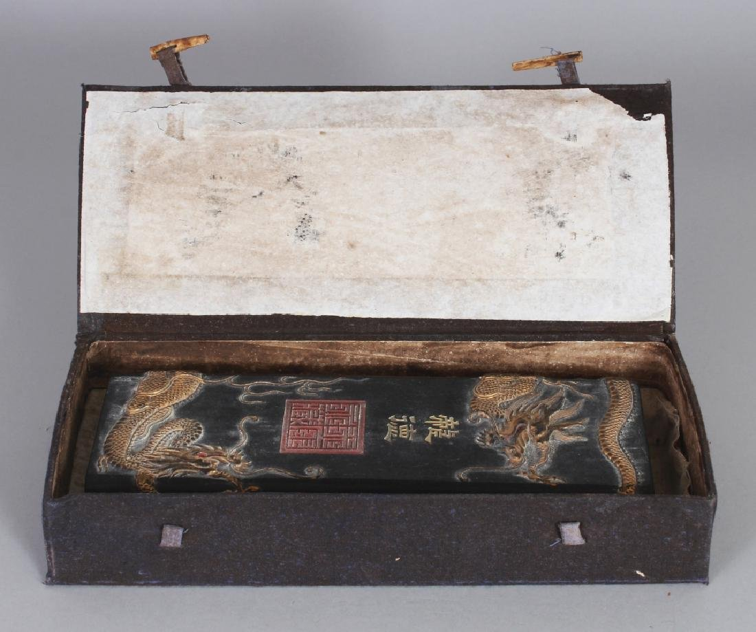 A CHINESE GILT DECORATED & MOULDED RECTANGULAR BLACK - 10