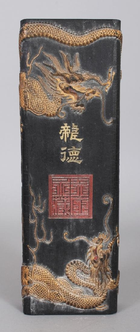 A CHINESE GILT DECORATED & MOULDED RECTANGULAR BLACK