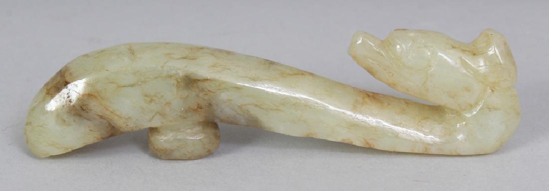 A CHINESE CELADON JADE BELT HOOK, 3.25in long.