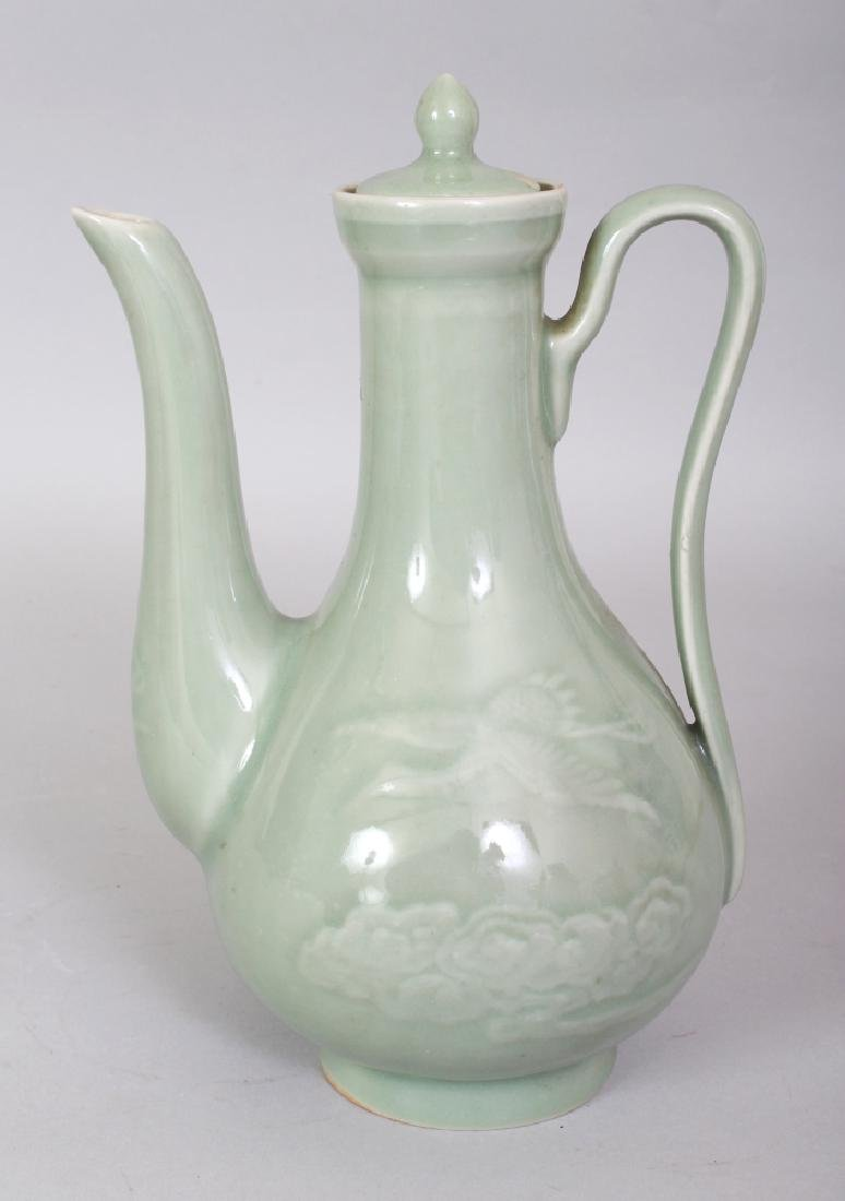 AN EARLY 20TH CENTURY JAPANESE CELADON PORCELAIN EWER &