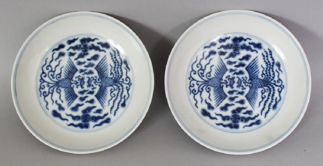 A PAIR OF CHINESE BLUE & WHITE PORCELAIN PHOENIX SAUCER