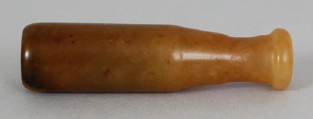 A CHINESE JADE CIGARETTE HOLDER, 2.6in long.