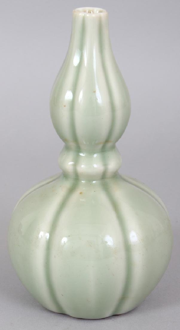 A CHINESE CELADON DOUBLE GOURD PORCELAIN VASE, of