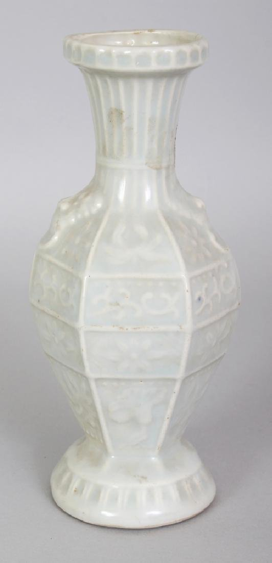 A CHINESE SONG STYLE CELADON GLAZED MOULDED PORCELAIN